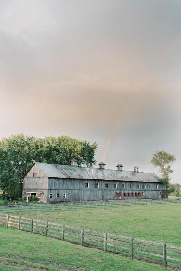 rainbow over the poplar barn during wedding at Sylvanside Farm