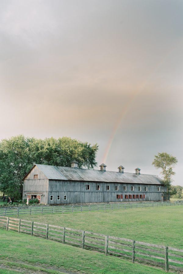 rainbow over the poplar barn during wedding at Sylvanside Farm